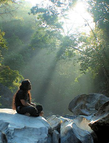 man praying in the sunlight