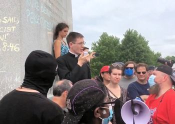priest evangelizes protestors