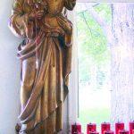 prayer candles at a statue of Saint Joseph