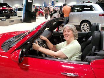 Terry having fun pretending to drive a red car