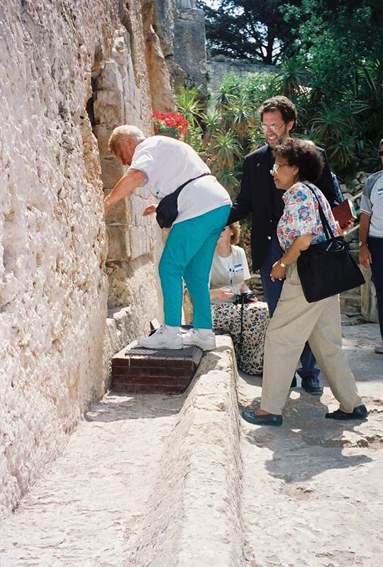 Examining the door way of the Garden Tomb