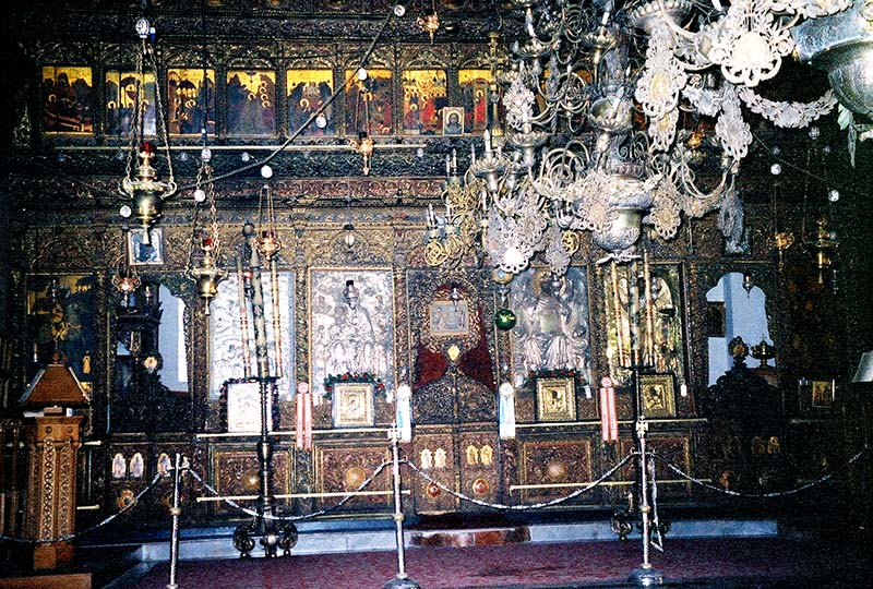 Armenian Orthodox sanctuary adorned with silver,lamps and painted icons