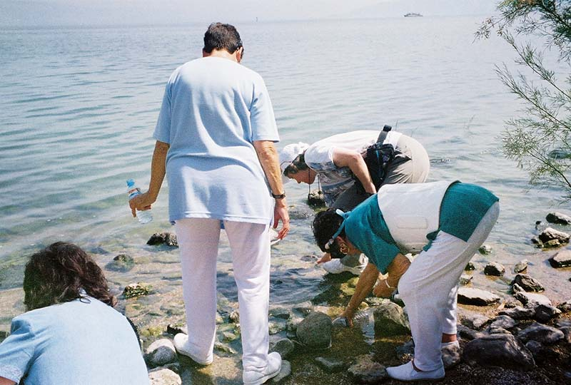 Collecting water from the Sea of Galilee